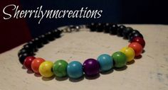 Check out this item in my Etsy shop https://www.etsy.com/listing/249552393/rainbow-colored-howlite-and-matte-onyx