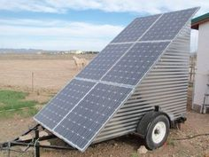 Solar panels on the mobile off-grid solar power system mounted       on a…