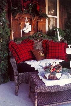 .Country Christmas on the porch | skates | red pillows | lace doilies.