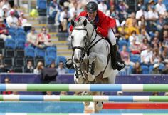 McLain Ward of the U.S. rides Antares during the equestrian individual jumping first qualifier in Greenwich Park at the London 2012 Olympic Games August 4, 2012.