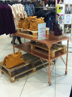 AW13 textured spray paint copper table and wooden palettes display