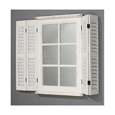 Featuring a shutter and window design this wood and glass mirror creates a striking focal point mounted on neutral walls or complements the sunny palette and. Arched Window Mirror, Arched Windows, White Shutters, Window Shutters, Shutter Wall, Shabby Chic Dining, Wall Mounted Mirror, Wall Mirror, Neutral Walls