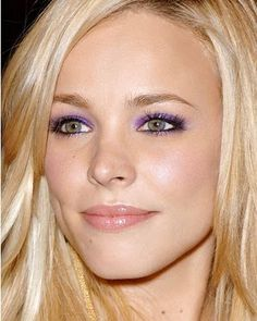 Green Eyes with black liner and purple smokey shadow.