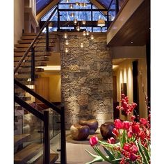 A welcoming entry foyer by Knudson Interiors  #foyer #modern #stonework #masonry #wood #glass #chandelier #pendants #light #lightandshadow #inpraiseofshadows #denver #contemporary #entry #staircase #stairs #interior #interiors #interiordesign #design #architecture #modernarchitecture ( # @homeadore via @latergramme )  #SpringGreenInteriorDesign #SpringGreenDesign #SpringGreenLoves