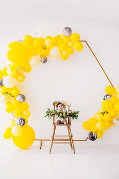 Bee themed first birthday photo shoot! Create this look with a gold hexagon backdrop stand + yellow balloon garland + a vintage gold highchair. Girl Birthday Themes, Girl Themes, First Birthday Photos, Girl First Birthday, Baby Birthday, First Birthday Parties, Balloon Backdrop, Balloon Garland, Yellow Balloons