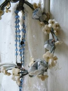 Rosary and floral crown - makes me think of May Crowning