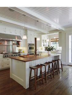 I would love a butcher block island- maybe with some open shelving to show off my dutch ovens?