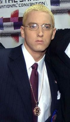 Eminem in a suit during the Encore tour (ca. 2004).