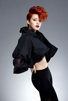 Short punky red ginger hair colour mohawk big volume curly style