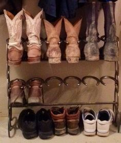 Bought this horse shoe boot rack today from a local craft fair. Neatened up the area near the back door.
