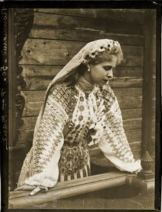 Queen Maria of Romania in a traditional folk costume.