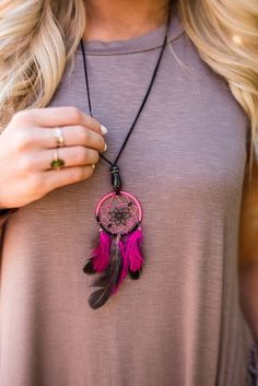 Dream a little dream with these miniature dreamcatcher necklaces. Adorned with a…