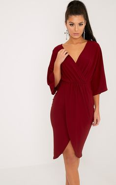 Burgundy Cape Midi Dress Featuring elegant midi length and a contemporary wrap design, this slee...