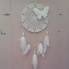 """9"""" White Crochet Doily Dream Catcher with a butterfly, white shell beads, and a Hamsa charm. The Hamsa is a protective symbol believed to ward off the evil eye."""