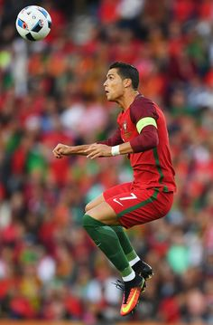 Cristiano Ronaldo Photos Photos - Cristiano Ronaldo of Portugal jumps to win a header during the UEFA EURO 2016 Group F match between Portugal and Austria at Parc des Princes on June 18, 2016 in Paris, France. - Portugal v Austria - Group F: UEFA Euro 2016