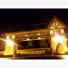 Great use of exposed timbers, stucco, stone and lighting. Entrance to Paramount subdivision in Meridian Idaho.