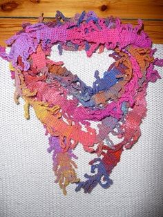 Peppy Scarf...I am making this right now and stopped to pin. It is just the right nonsense I was looking for. Using a colorful verigated and it just looks delightful. You need to know chain stitches, single crochet and must be able to count to 6 and 30...lol  Enjoy! psp