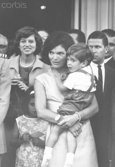 Jackie Kennedy, John Jr., and Eunice Shriver at the White House President Kennedy's sister Eunice Shriver, First Lady Jacqueline Kennedy, and her son John Jr. at the White House, North Portico, May 24, 1963. Date:May 24, http://en.wikipedia.org/wiki/Jacqueline_Kennedy_Onassis   http://en.wikipedia.org/wiki/John_F._Kennedy,_Jr.  http://en.wikipedia.org/wiki/Eunice_Kennedy_Shriver