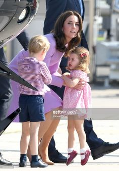 Prince George, Princess Charlotte of Cambridge and Catherine, Duchess of Cambridge view helicopter models H145 and H135 before departing from Hamburg airport on the last day of their official visit to Poland and Germany on July 21, 2017 in Hamburg, Germany.