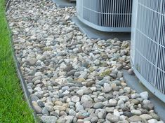 Landscaping around pool on pinterest pools landscaping for Smooth stones for landscaping