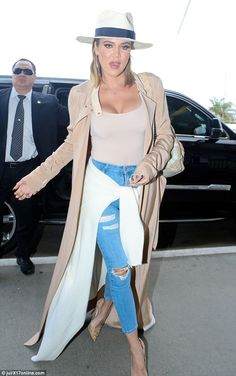 All wrapped up:Khloe Kadashian showed how layering is done as she flew out of Los Angeles on Tuesday