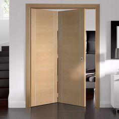 Bespoke Thrufold Forli Oak Flush Folding 2+0 Door with Aluminium Inlay - Prefinished - Lifestyle Image.    #modernoakbifolds #bifoldingdoors