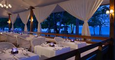 Have a meal on the beach at Couples Negril's Heliconia Outdoor Dining.