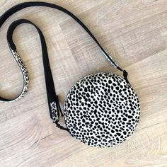 Cheetah print hair on hide circle bag in black and white