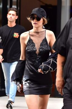 Do lingerie for day à la Gigi Hadid. Mix a slip dress with super casual accessories in the same color for a sleek look. We love this all black ensemble and hacked the look for WAY less.