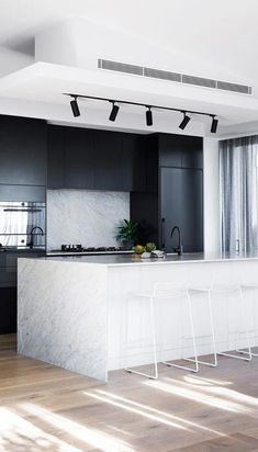 Best Interior Design Ideas : Mixing of Modern and Minimalist Style : cool modern kitchen decor idea // track lighting for the ktichen // black stainless appliances // black cabinets // marble wrapped island // minimal modern white stools White Wood Kitchens, Cool Kitchens, Beautiful Kitchens, Rustic Kitchen, Kitchen Decor, Kitchen Ideas, Kitchen Trends, Kitchen Black, Kitchen Designs