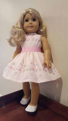 Light pink embroidered eyelet dress with removable sash, fully lined with Velcro closure * All seams are serged for a clean, professional finish * Fits 18 inch dolls, including American Girl ® * Doll & shoes not included * Smoke/Pet home