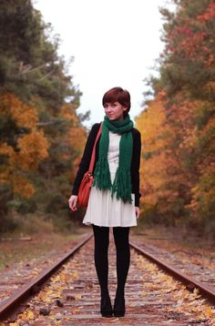 Simple is awesome.    White dress, green scarf, dark tights and cardigan.