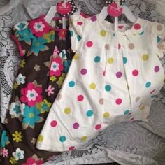 Never worn baby girl dresses, both with tags