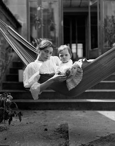 A mother and child, swaying together in a hammock. Their facial expressions are amazing. by kate barry