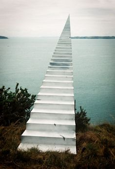 Walking to the Mainland by David McCracken. In this photo manipulated image the photographer could be alluding that there is a heaven and that the flight of stairs leads to this land of eternal paradise.