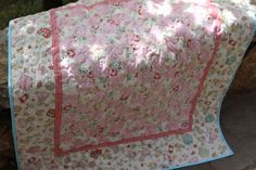 Baby girl quilt by http://quiltingstories.blogspot.com/2014/05/pink-baby-girl-quilt-finished-binding-sashing.html