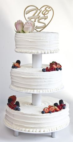 Buttercreme wedding cake, etagere, fresh berries, wood cake topper