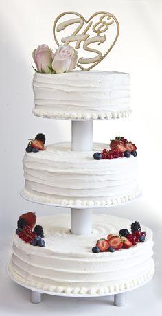 Buttercreme wedding cake, etagere, fresh berries, wood cake topper