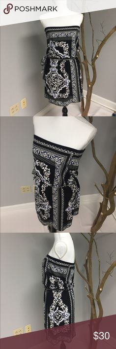 """White House Black Market Scarf Dress Beautiful! Sexy! Classy! Scarf dress has tie sash at waist with loops. Black Background with accents of white and royal blue! Would look amazing with a royal blue stiletto! NWOT's, sadly never got to wear it. Looks amazing on, very flattering to the shoulders. 15.5"""" across top band, 10.5"""" top band to elastic waist, 17"""" skirt, 14.5"""" unstretched waist. White House Black Market Dresses Strapless"""