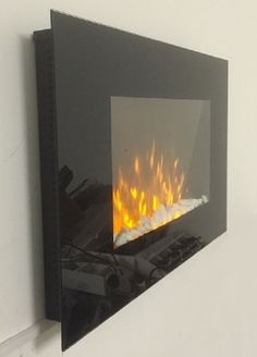 TruFlame Wall Mounted Flat Glass Electric Fire with Pebble Effect (90cm wide square corners) 1000w or 2000w heat with timer 90.0 (W) 56.0 (H) 9.0 (D) cm Flame only setting CE compliant Time and Day shown on new onscreen menu Thermostatically controlled heating (15-30 degrees C) Heating setting shown (min, max or auto) on onscreen menu Flame Brightness shown (5 levels) on onscreen menu
