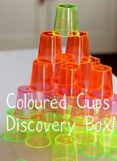 Encourage open-ended investigative play with a toddler discovery box! This one contains neon shot glasses for exploring coloured light and shadows.
