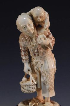 Wonderful Japanese poly-chromed carving of male figure with a monkey on his left shoulder, feeding him with an apple in his left hand, carrying a fruit basket with the right hand, fine workmanship with attention to details, early to mid 20th century period, artist's signature to the base. Size; Height of carving, including 1.5 inch wood base, is 7 inches.