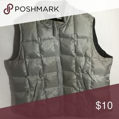 Arizona❄️quilted feather/down❄️nylon vest Gently pre owned quilted nylon vest in a light gray, almost silver color made by Arizona Jean Company. Size: X-LARGE Lining: 100% nylon. Fill: feathers & down. Features buckles to draw vest in at the waist. See photo No. 2. 💥📷MORE PHOTOS COMING SOON📷💥 Arizona Jean Company Jackets & Coats Vests
