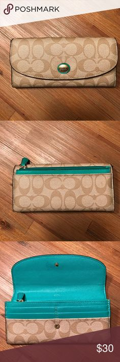 Authentic Coach Wallet! Beautiful Authentic Snap closure Beige and Teal Coach Wallet with classic logo print. Has 14 credit card slots, 2 cash slots, a zipper for coins and could fit a check book in there. In the back,  there is cute small teal pouch that comes out and could be used as a small accessory pouch.  I only used this wallet a couple times but somehow managed to get a pen mark on the inside next to the snap closure. There is a picture of the pen mark so please know that there is a…