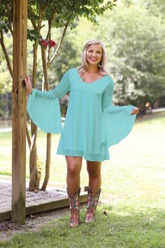 Wrangler® Western long sleeve turquoise v-neck dress with crochet at sleeves.