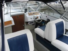 1971 Chris Craft Lancer 23. Differences from 19 include high rail around the nose, recessed walkway, forward enclosed cabin.