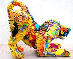 Recycled plastic toys into dog sculpture -- great lawn ornament! Especially for those of us dog lovers that perhaps can't house a dog currently (allergies, too small apt., etc.). I feel for you, guys!