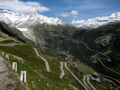 Two passes in the Swiss Alps:  Furka Pass in the distance, with Gletsch in the valley, as seen from the summit of Grimsel Pass - photo by Cooper.ch, via Wikipedia;  in Switzerland;  a tunnel opened in 1982 that bypasses the Furka Pass