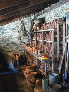 potting shed look I love. stone, racks of pots- how the nursery industry used to be