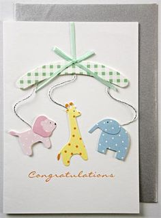 handmade card ... baby mobile ... clean and simple design ... light and lovely colors ... clever use of animal punches/fussy cut little animals ... sweet card!!